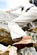 Anonymous woman scaling rocky walls