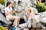 Young women hikers enjoying a hot drink