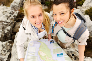 Carefree hikers with a map