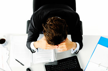 Overworked worker is stressed
