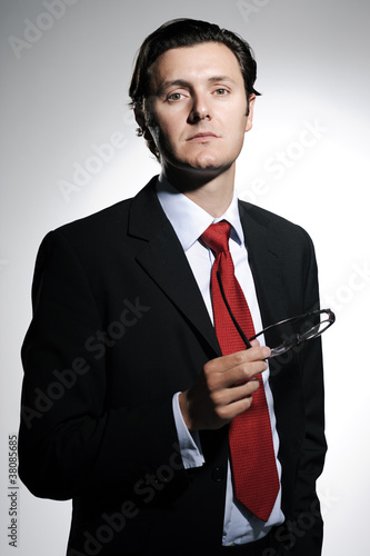 Relaxed businessman in red necktie