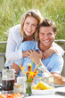 Couple on vacation eating outdoors