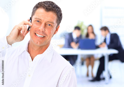 business man speaking on the phone while in a
