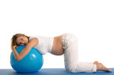 pregnant woman practicing yoga with blue ball