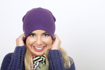 A cheerful young woman in winter
