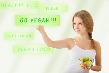 beautiful young  woman  with a salad choose vegetarianism