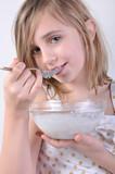 smiling child with a bowl of milk porridge