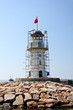 Lighthouse in port. Turkey, Alanya. Sunny weather.