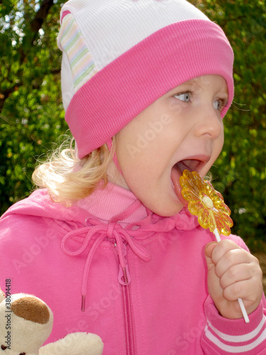 The child with a sugar candy