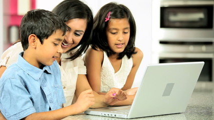 Young Asian Mother & Children Using Laptop