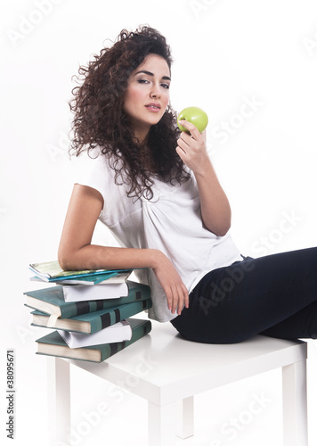 Attractive young lady taking some rest with an apple