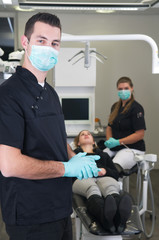 Dentist with nurse and patient