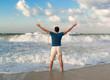 Happy man near Mediterranean sea