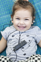 Girl listening to music player