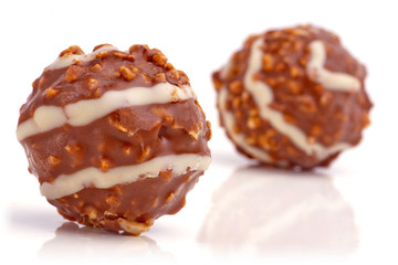 Sweet chocolate balls filled with hazelnuts.