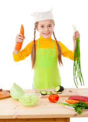 Little cooker with vegetables in hands
