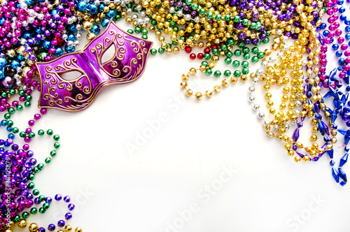 Leinwandbild Motiv Mask and mardi gras beads