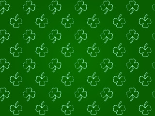 seamless texture with green shamrock.
