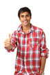 Thumbs up gesture by cute smiling guy