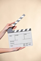 hands with clapperboard