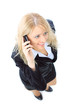Top view of young businesswoman talking on mobile phone