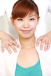 young Japanese woman getting shoulder massage