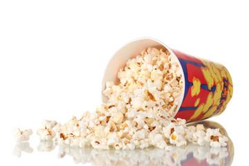 Full bucket of popcorn dropped isolated on white