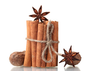 Cinnamon sticks, nutmeg and anise isolated on white