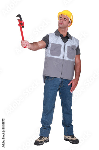 Man holding a pipe wrench
