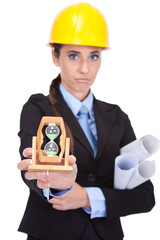 female architect showing a time