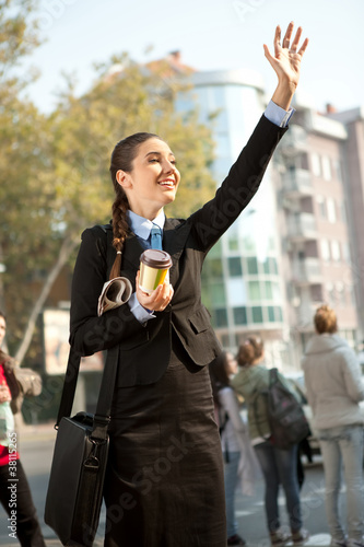 smiling businesswoman waving hello