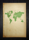 vintage world map on dark wood  background with clipping path poster