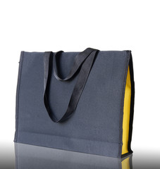 black shopping bag on reflect floor and white background