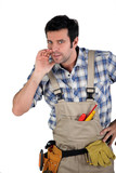 Handyman whispering on white background