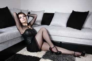 Gothic girl all in black leather in nice stockings