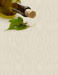textured background with wine bottle and grape leaf