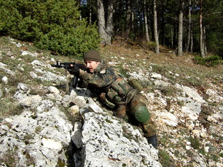 Soldier in camouflage airsoft sports