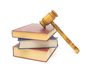 stack of books and gavel on white background