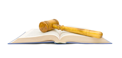 open book and gavel on white background