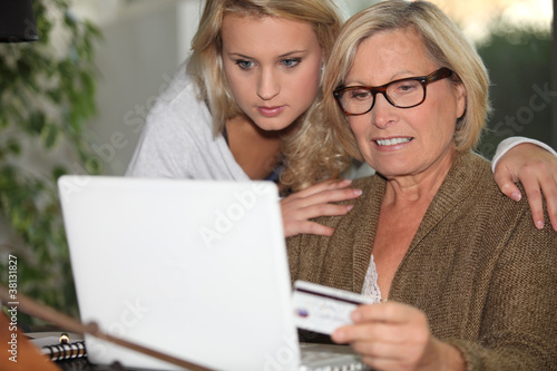 Senior woman and young girl in front of a laptop