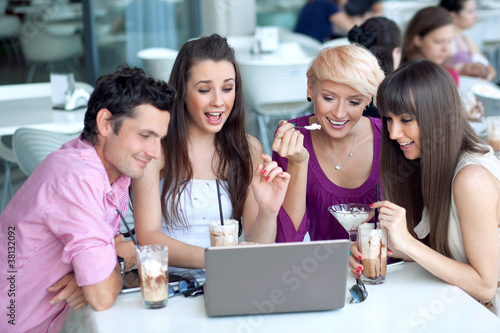Young people browsing internet in a restaurant