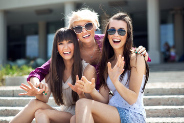Portrait of three young ladies wearing sunglasses