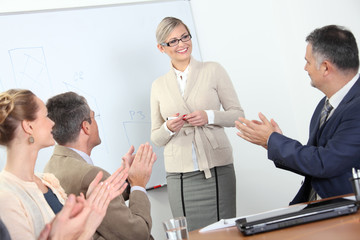 Business presentation - people applauding