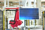 Fototapety Arbeitsroboter Solarzellenherstellung // solar panel factory