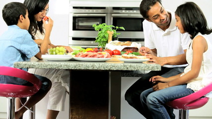 Young Asian Family Making Healthy Lunch Together