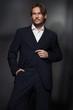 Handsome man wearing dark suit
