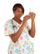 African American Nurse Checking Dosage in a Syringe
