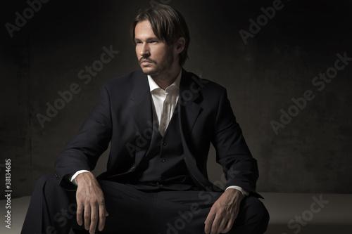 Fashionable man sitting