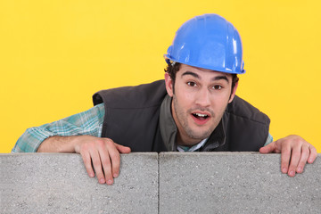 Bricklayer with a block wall