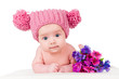 portrait of a beautiful baby in the hat with flowers